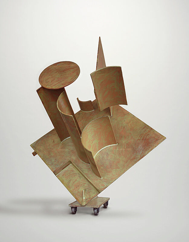 Abstract sculpture propped on wheels.