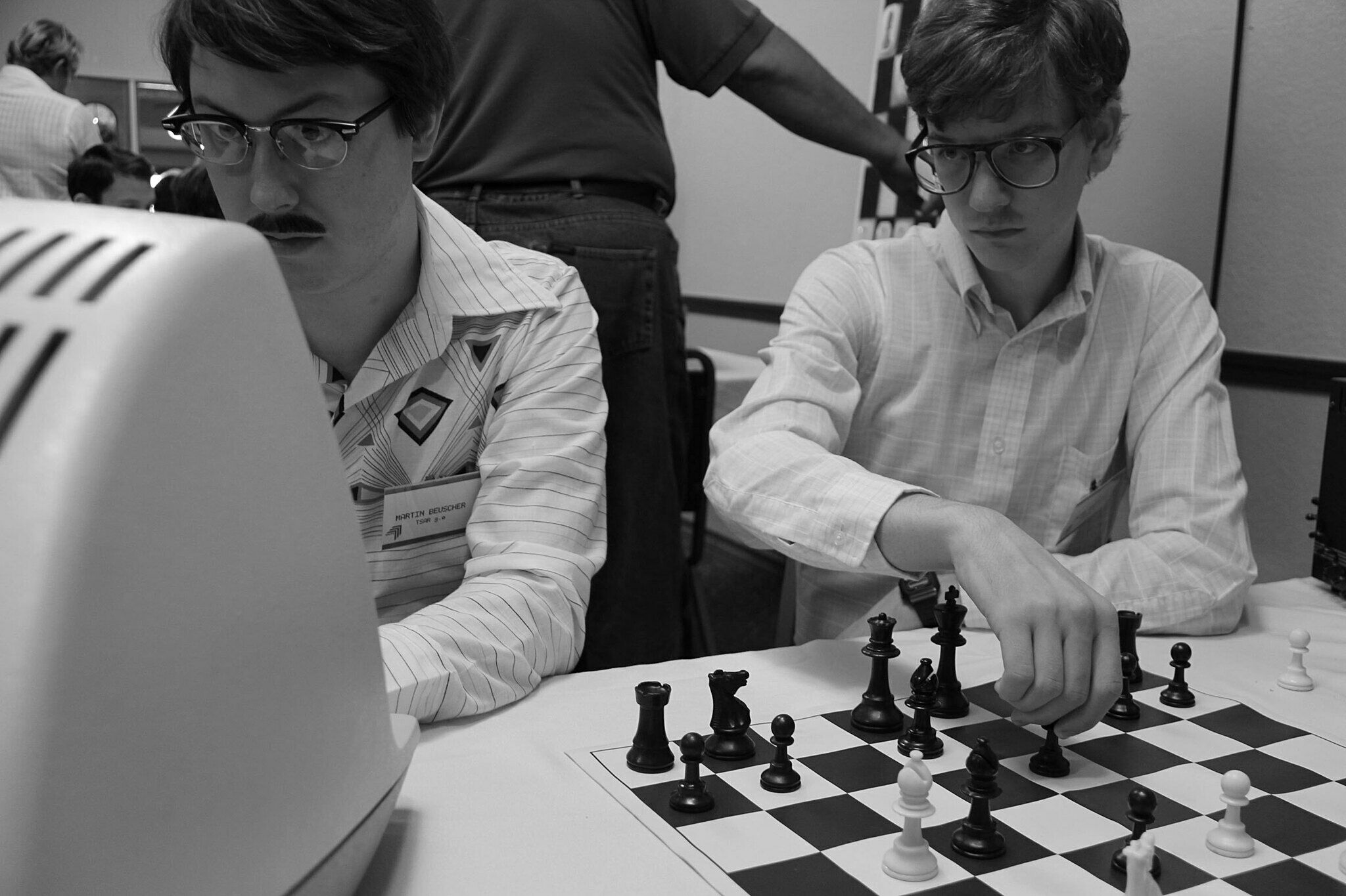 Photograph of people playing chess.