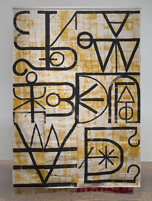 An artwork with black symbols.