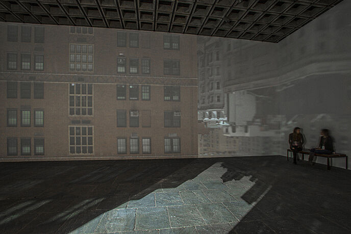 Projection on walls of the gallery of buildings.