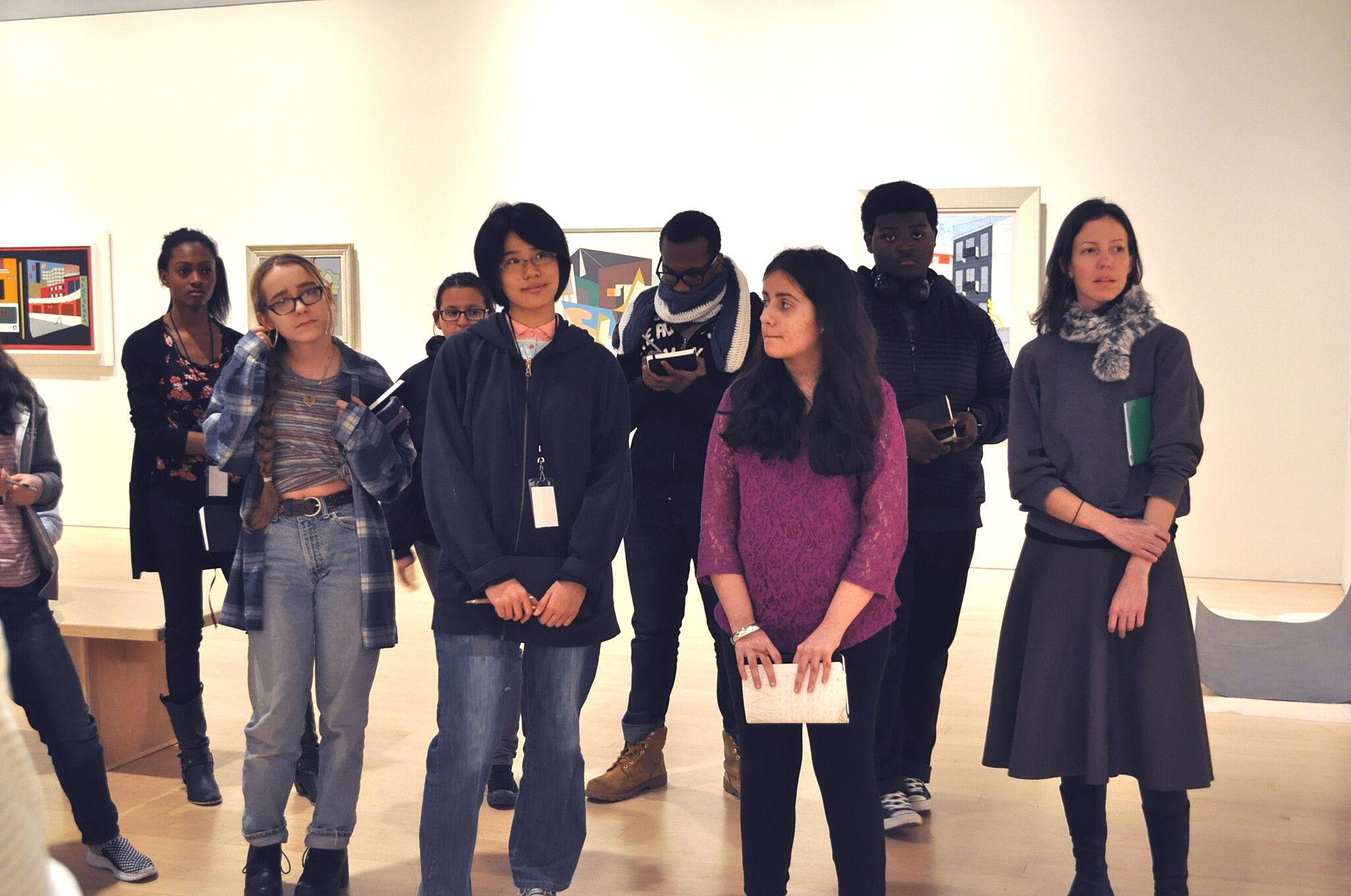 Participants discussing art works