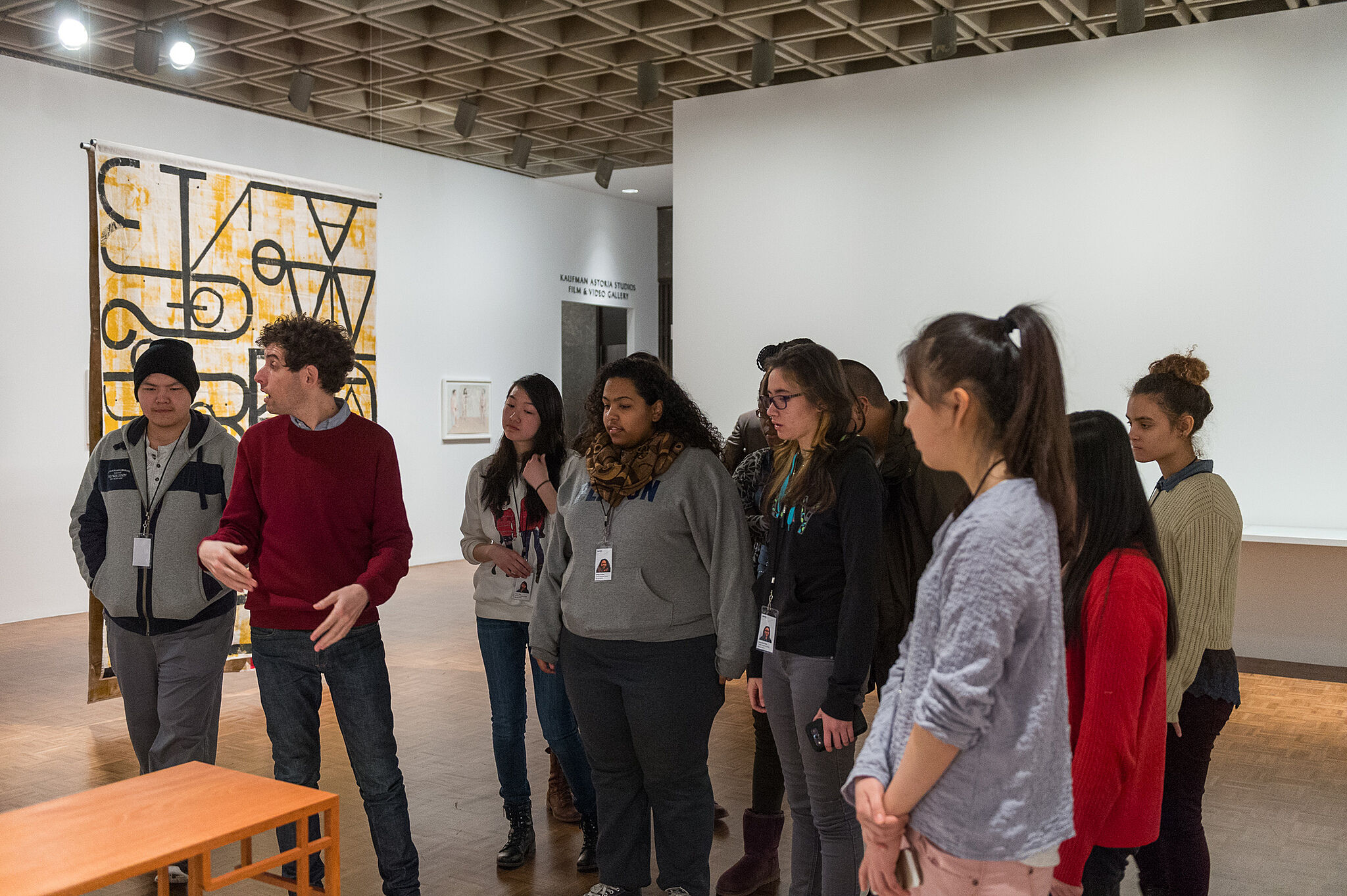 An artist takes a student group on a tour of a gallery.