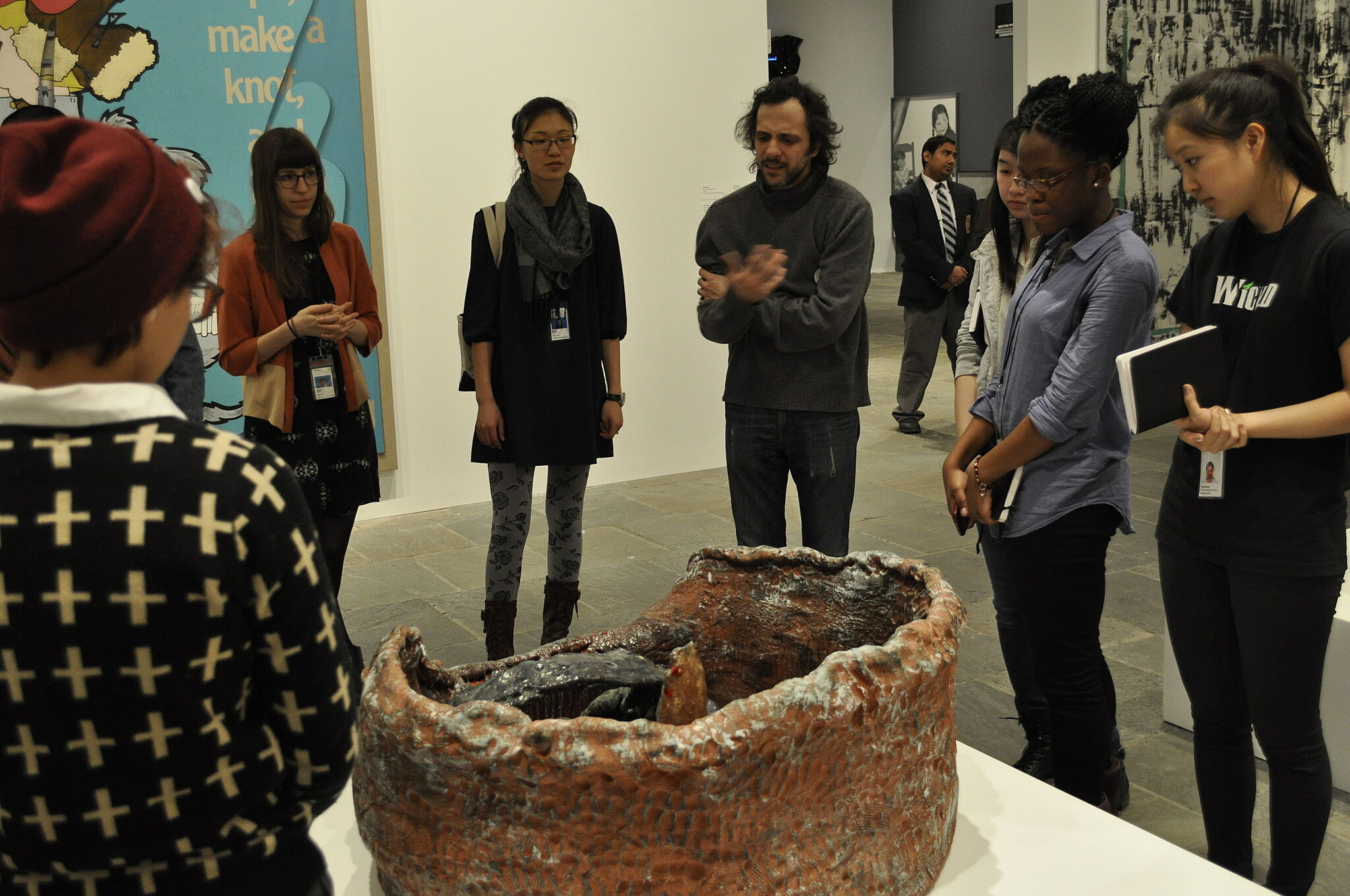 The artist takes youth leaders through a tour of the Biennial exhbiit.
