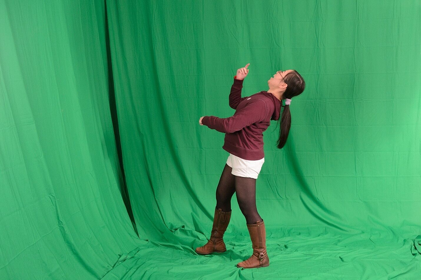 Y I Artist Sally performs in front of the green screen