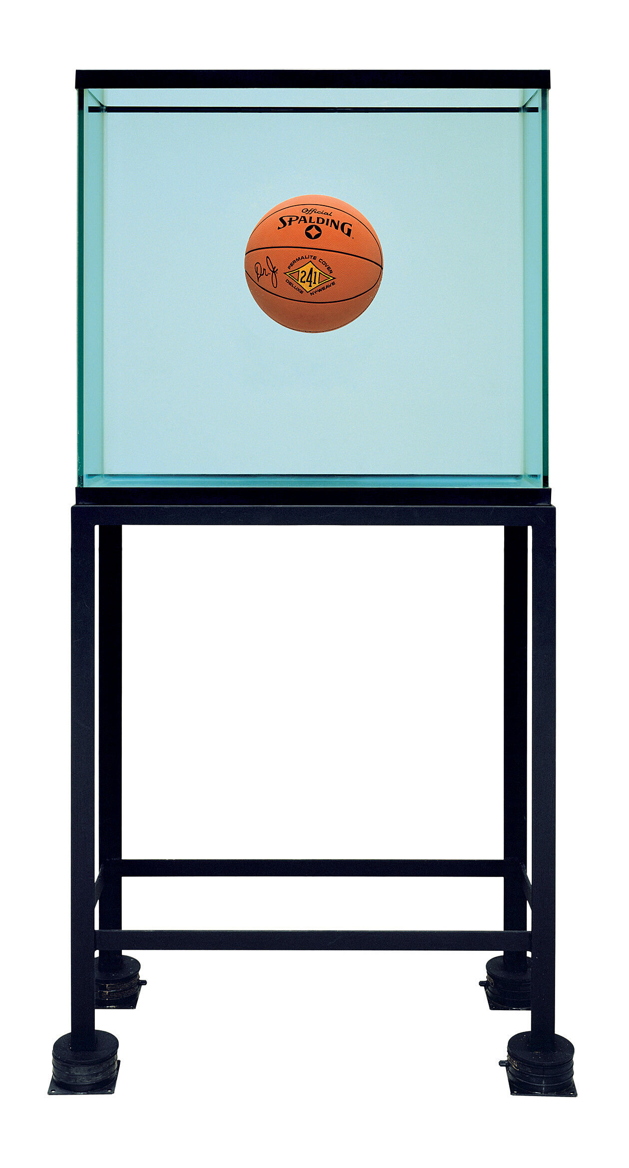 A basketball floating in a glass tank.
