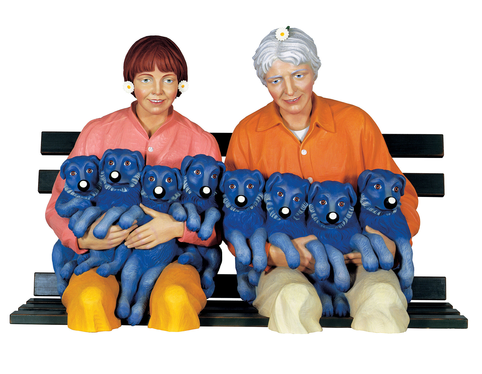 A sculpture of two people sitting on a bench holding 8 puppies.