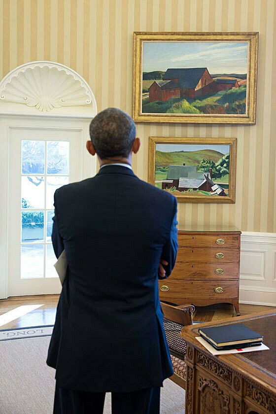 Obama looking at Hopper paintings in Oval Office.