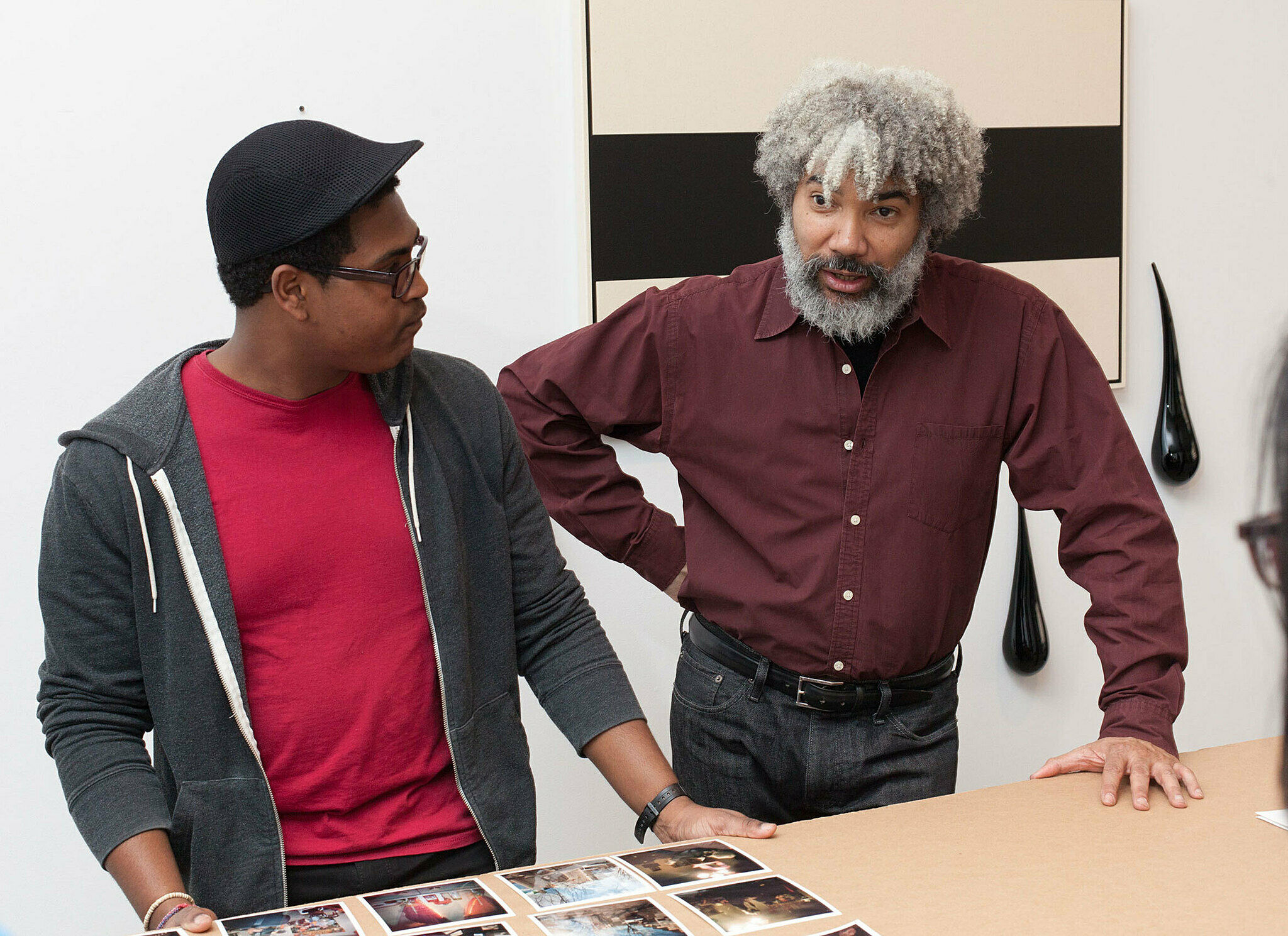 Artist discusses with a student.