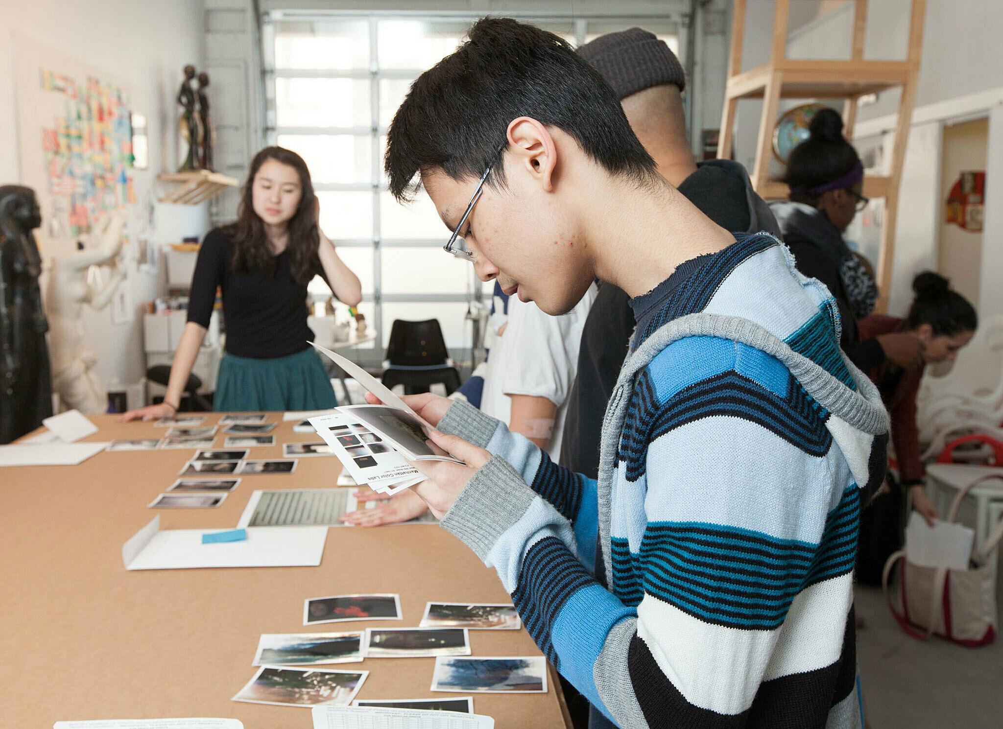 Students go through photographs.