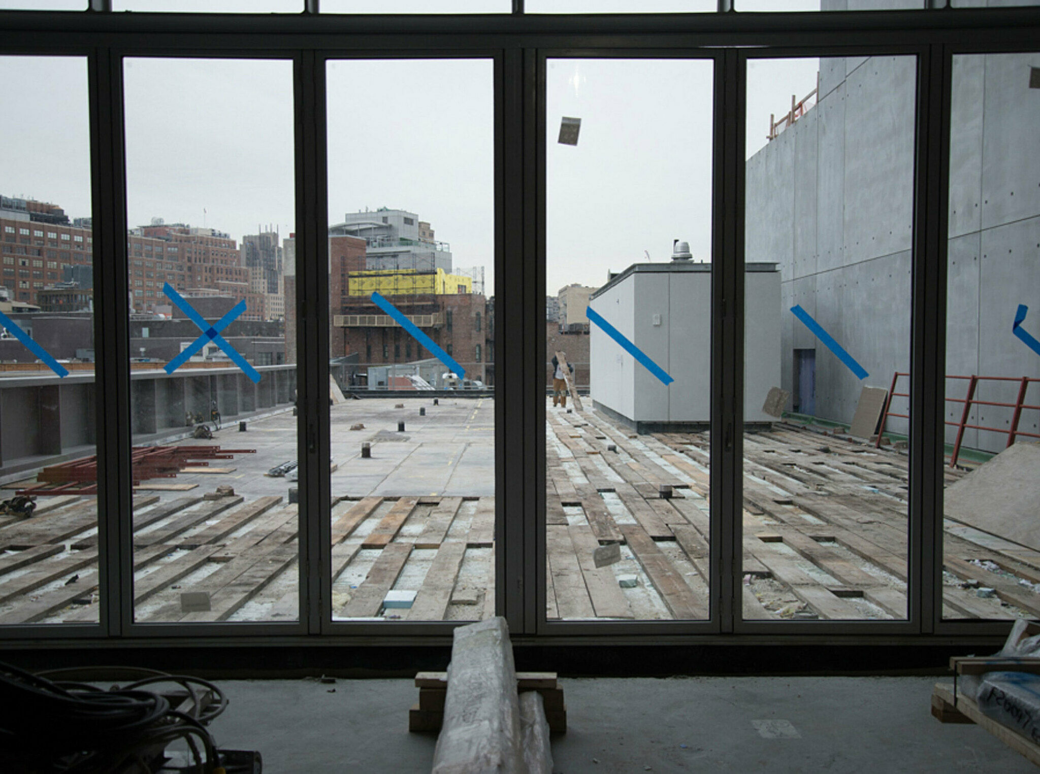 Windows looking out from the theater under construction.