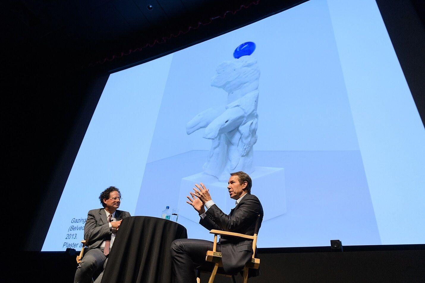 Two men discuss Koons's Gazing Ball (Belvedere Torso).
