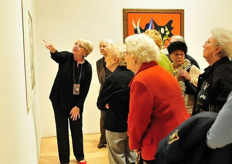 seniors learning about artwork in the gallery
