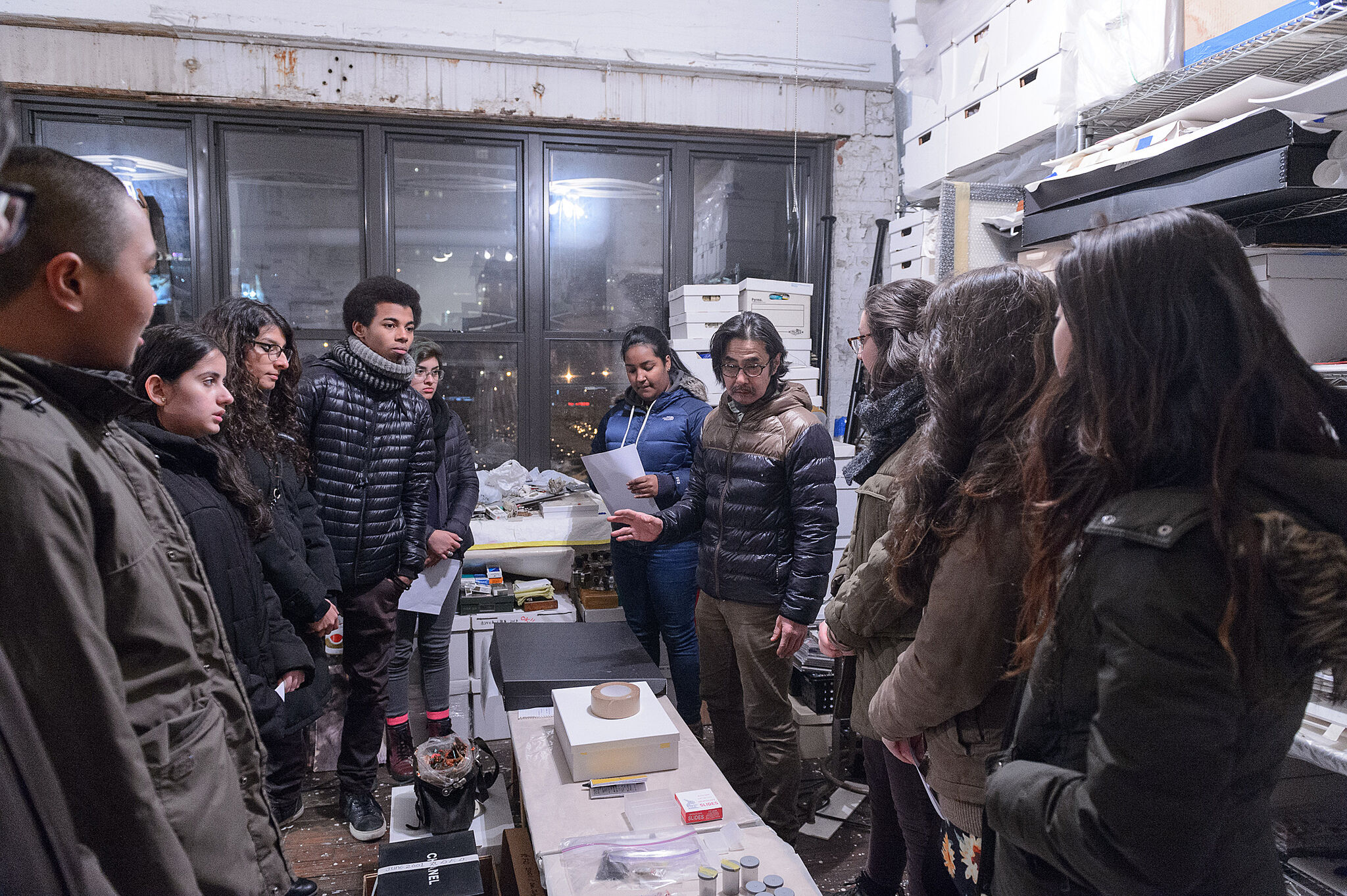 artist talking to students in his studio