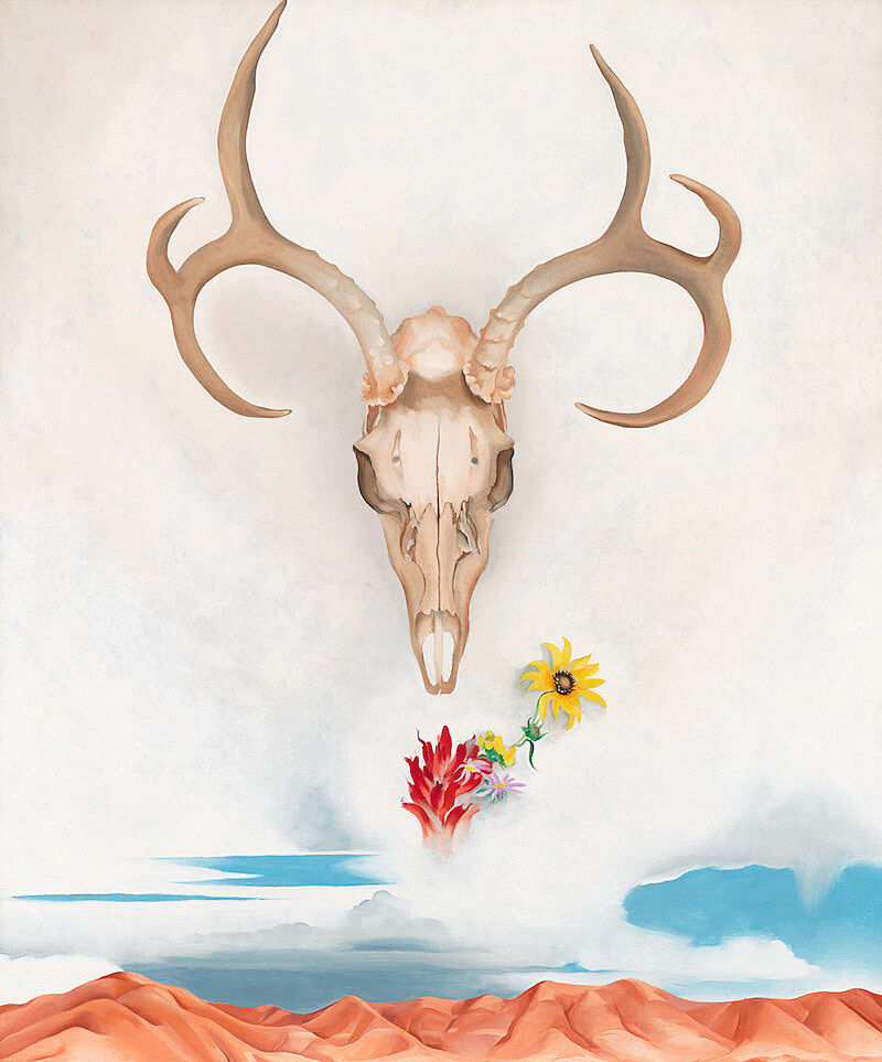 A painting of an animal skull in the sky above flowers and desert landscape.