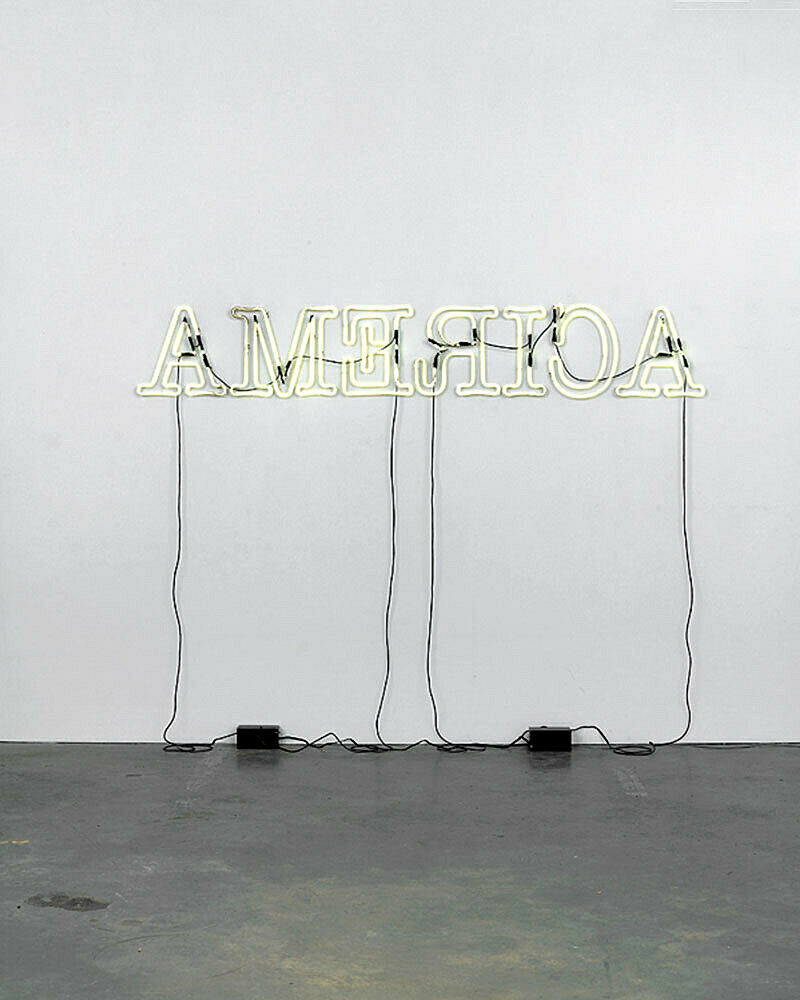 "A light installation that reads ""America"" with backwards letters."