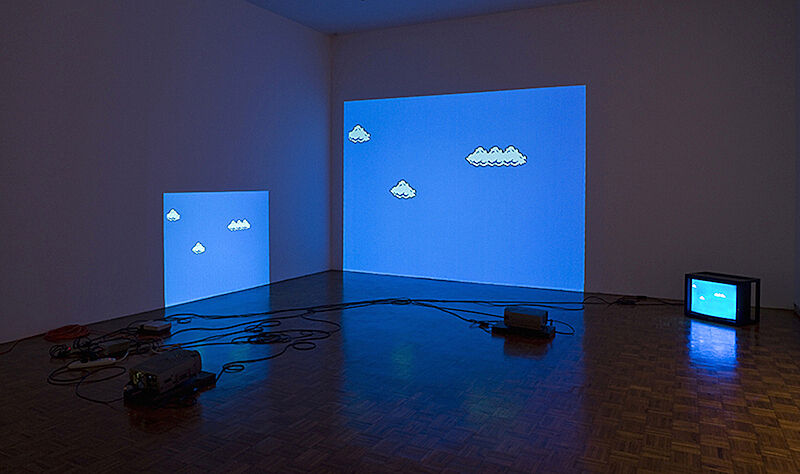An installation of projections on the wall of animated clouds in the sky.