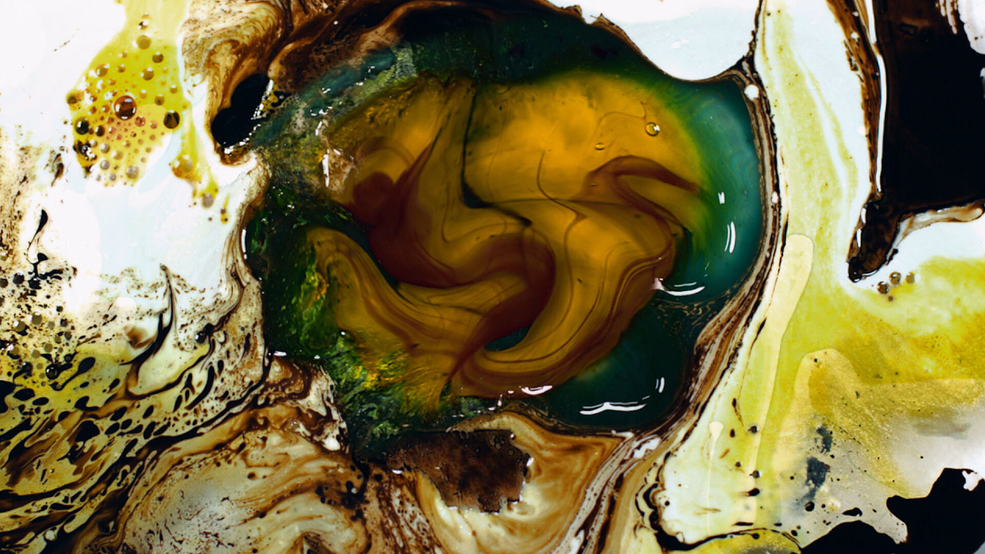 An flat, abstract image that resembles different liquids resisting one another.