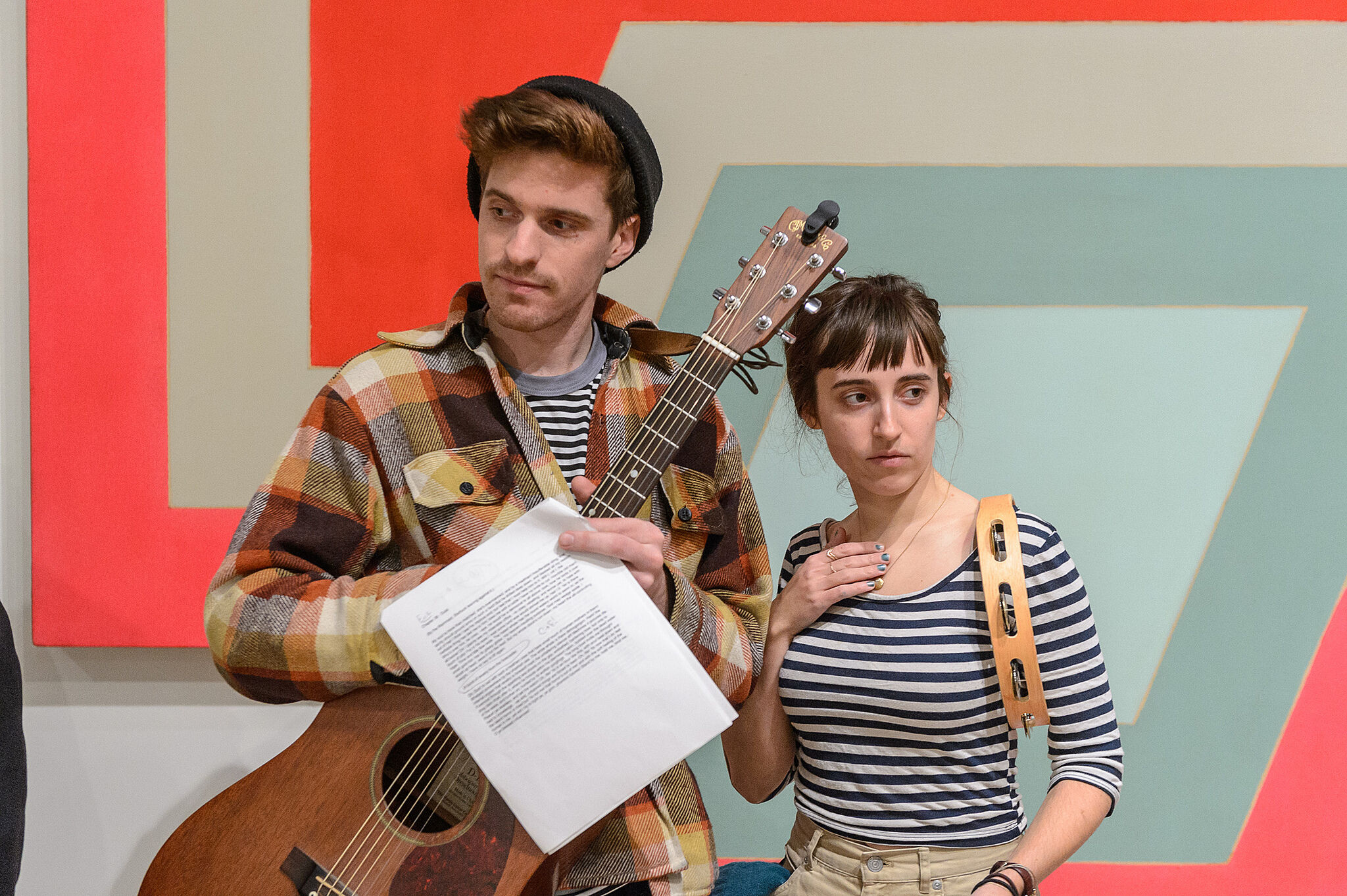Girl and guy with instruments.