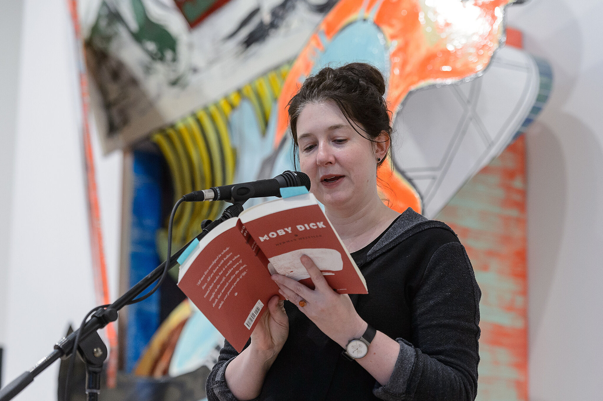 Woman reading from Moby Dick.