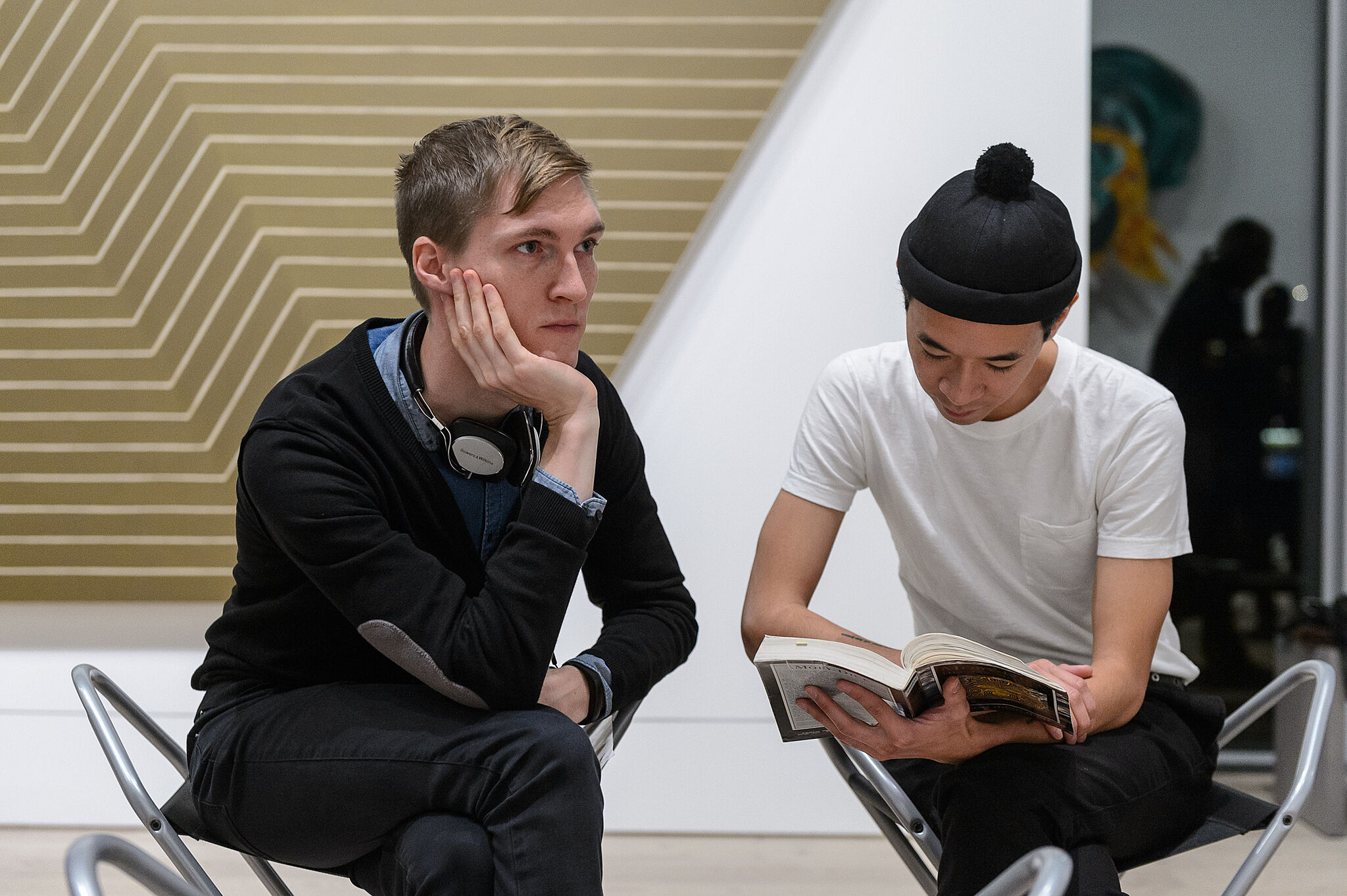 Two men reading the book.