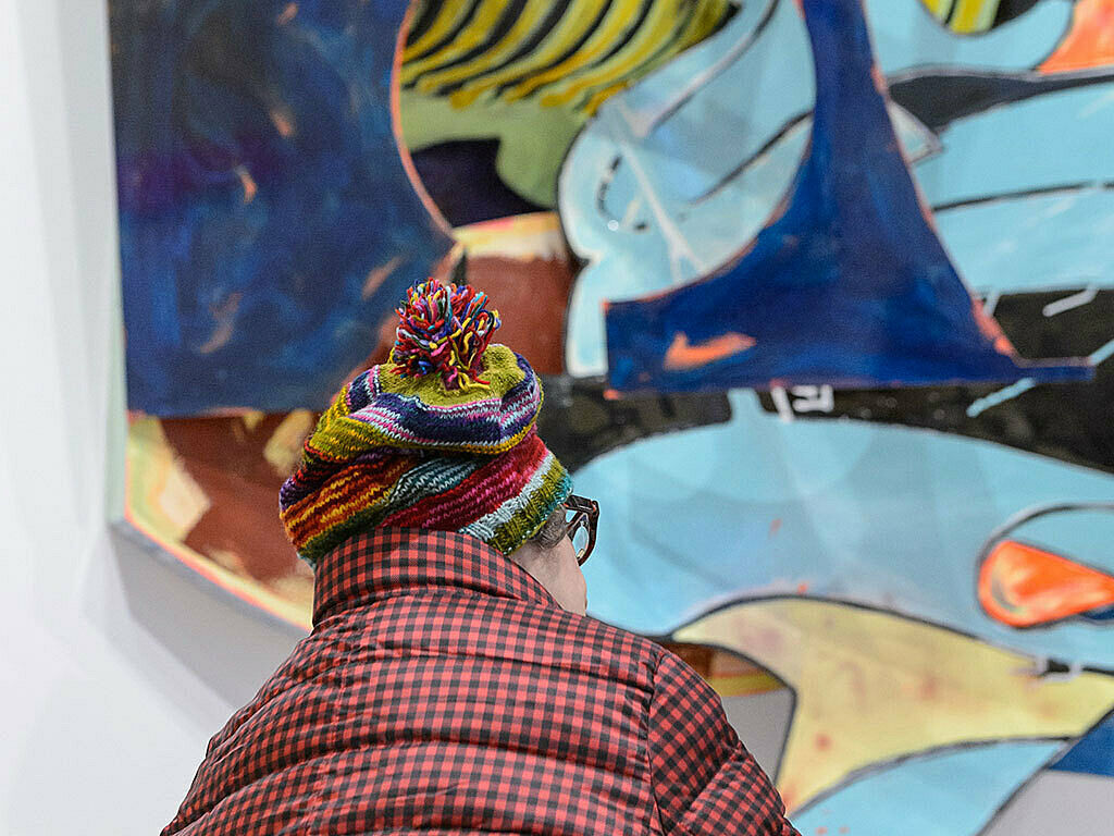 Colorful hat in front of installation.