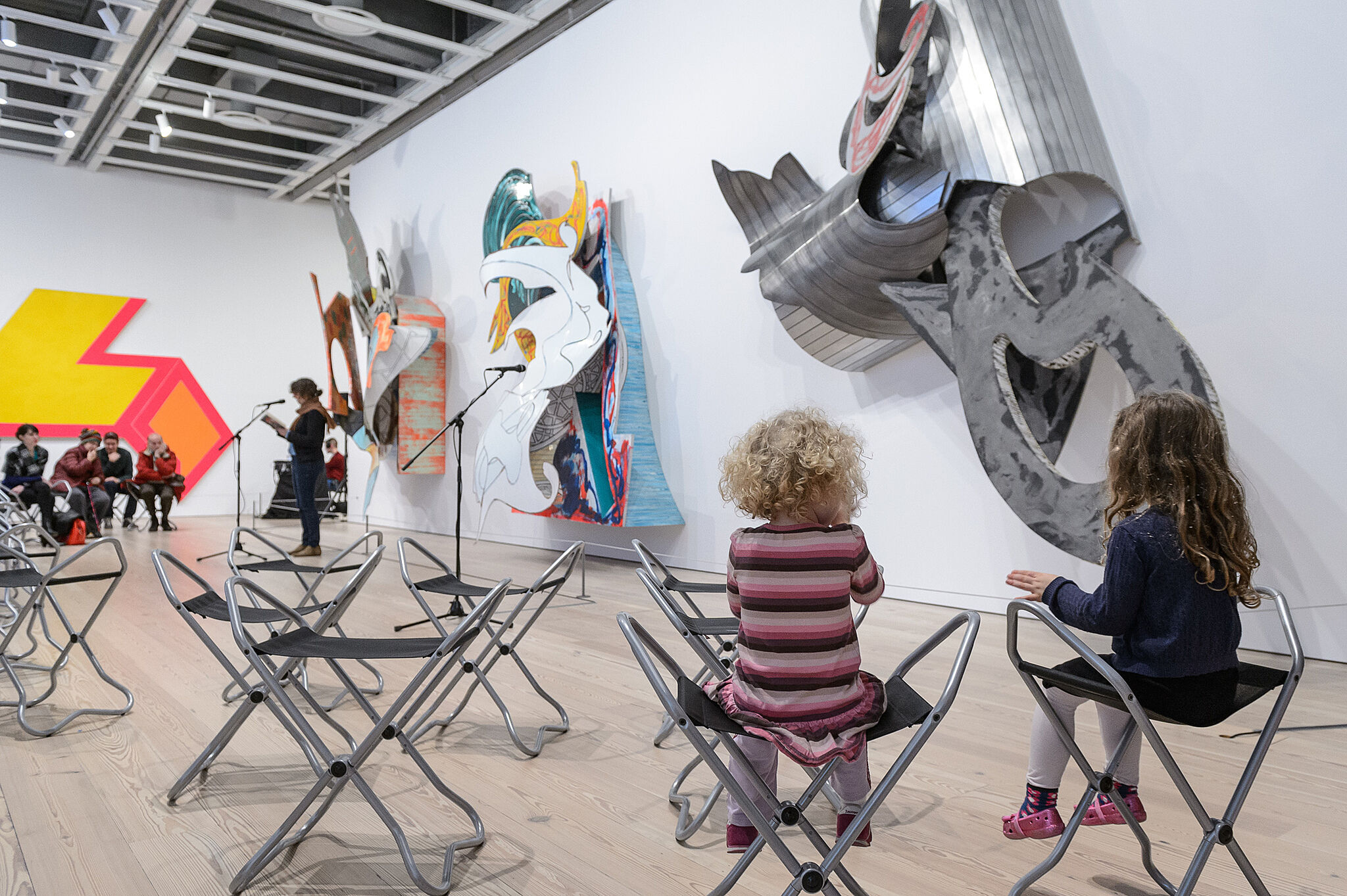 kids sitting in front of installations.