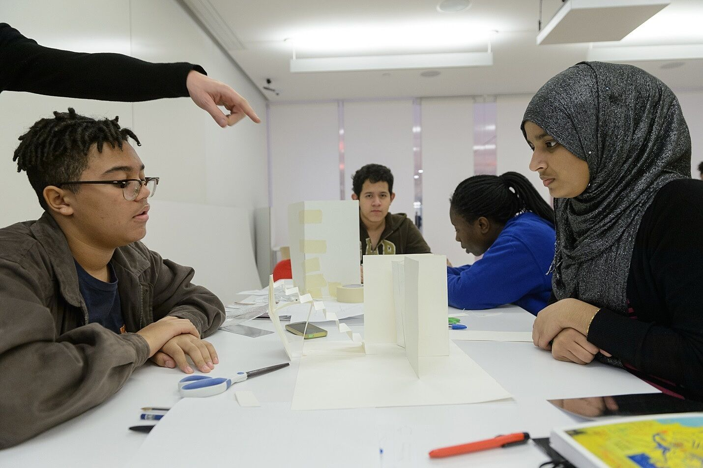 Teens work on a project with Ruiz in the Hearst Artspace