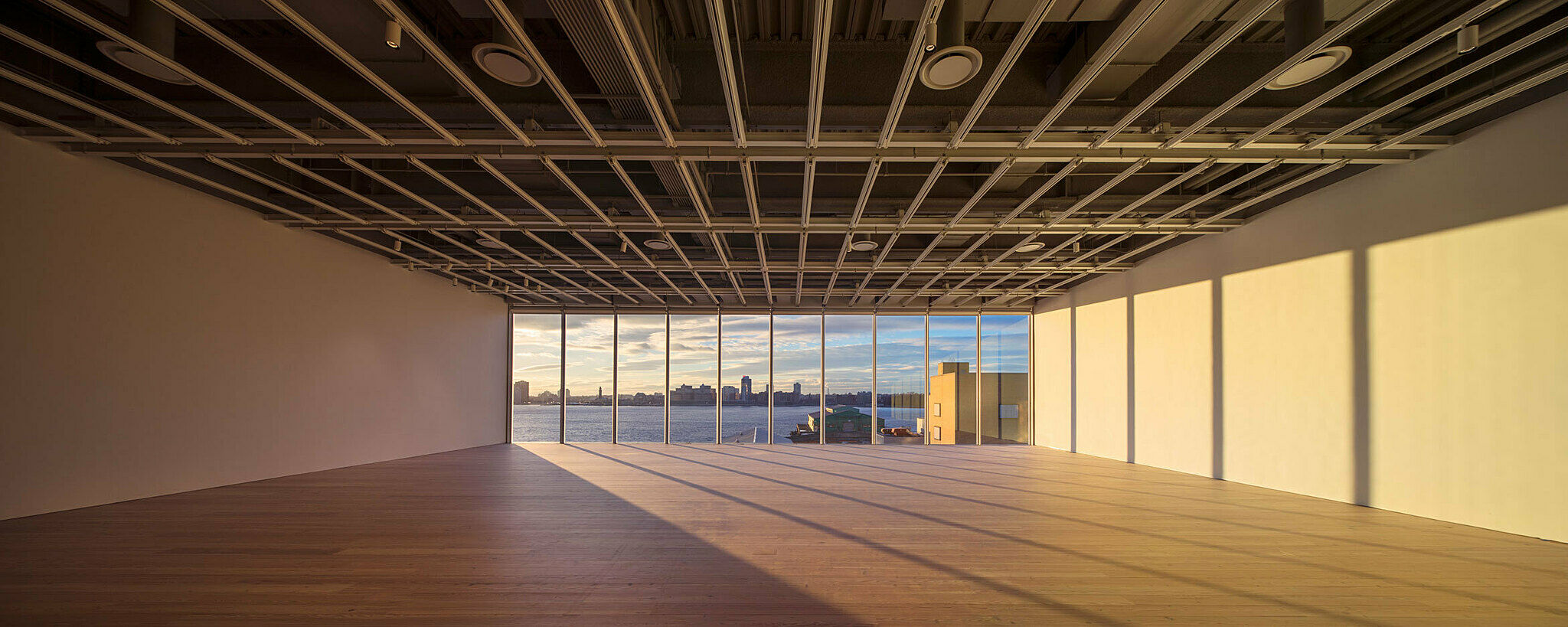The empty fifth-floor gallery looking out onto Hudson River.