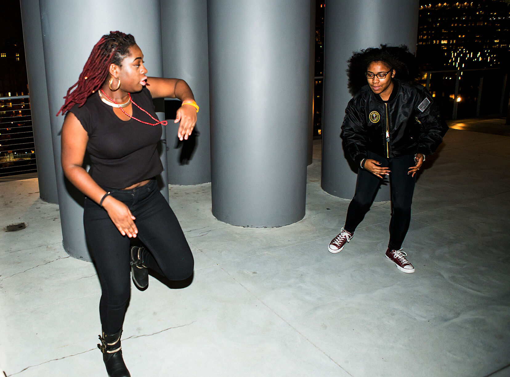 Two teens dance in a performance piece about Black Lives Matter.