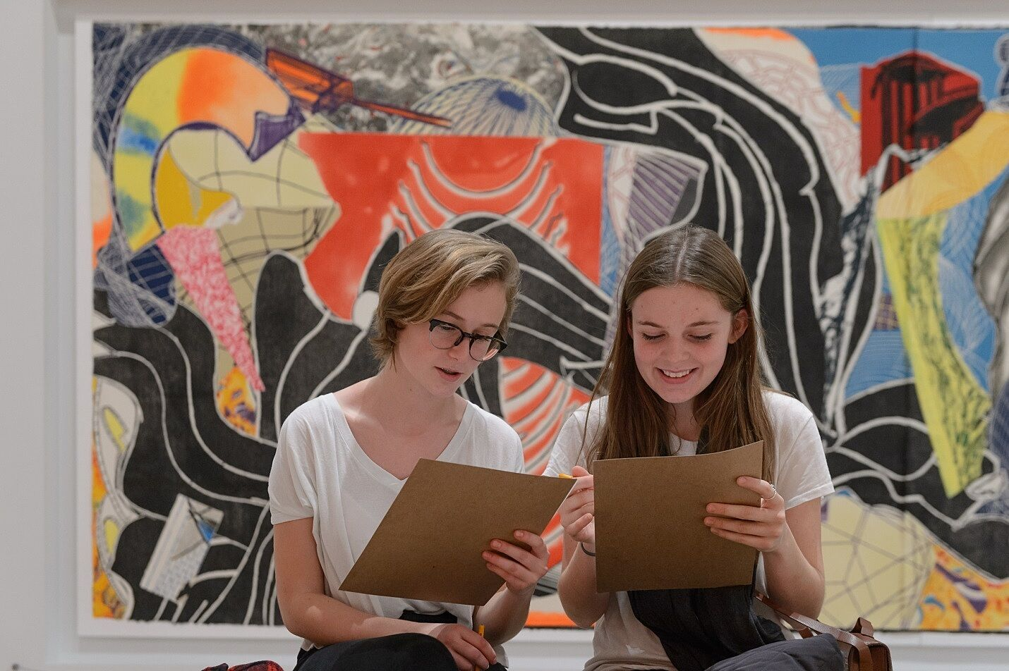 Teens complete assignment in-front artwork