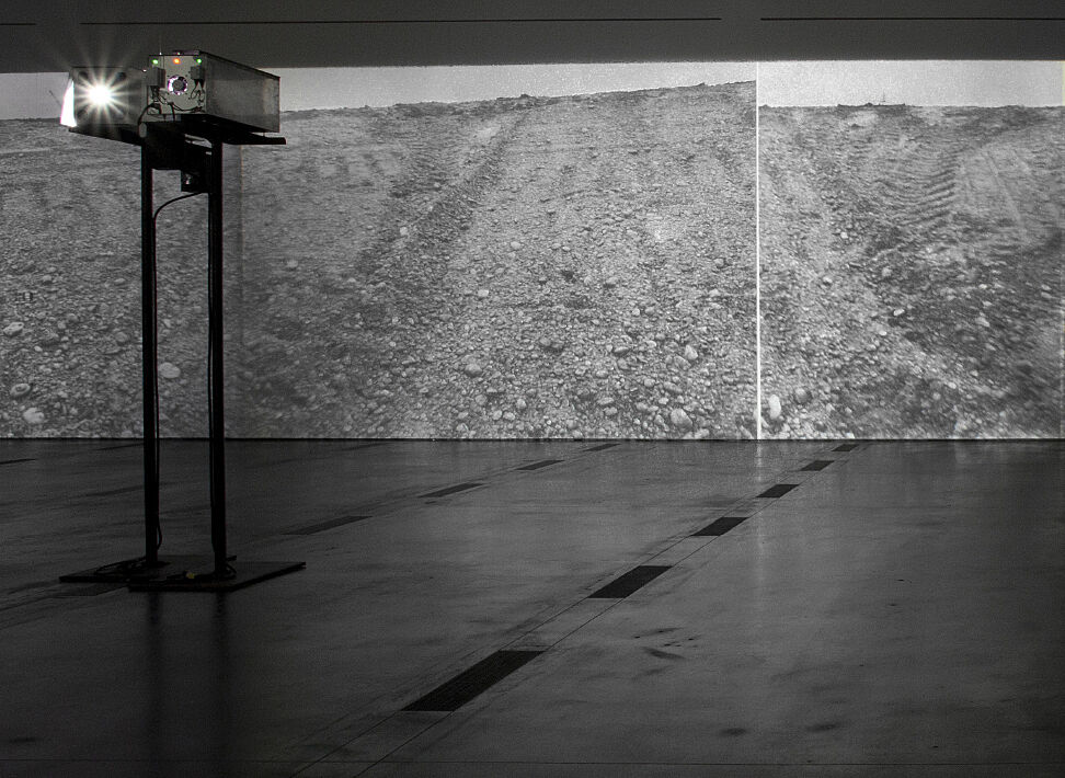 A black and white, projected work by Michael Heizer.