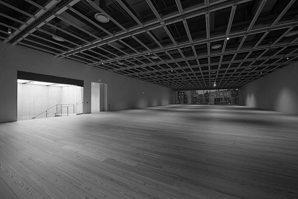The empty fifth floor galleries of the Whitney Museum lit at night