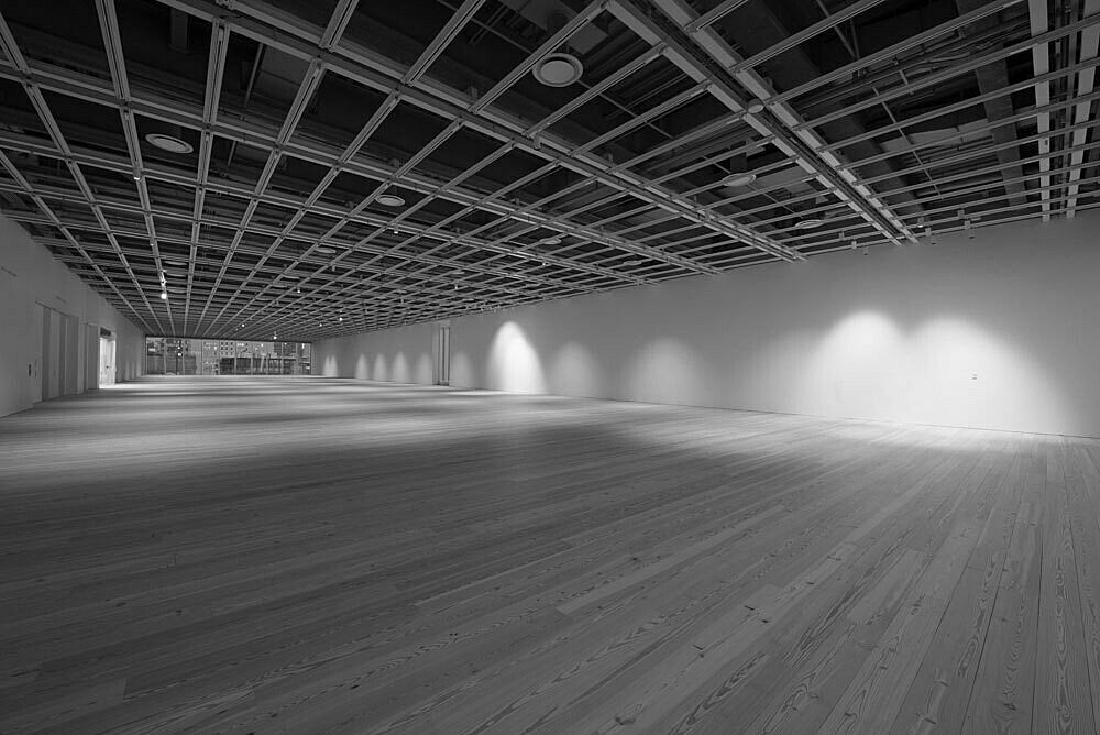 A view of the empty fifth floor Whitney galleries in black and white.