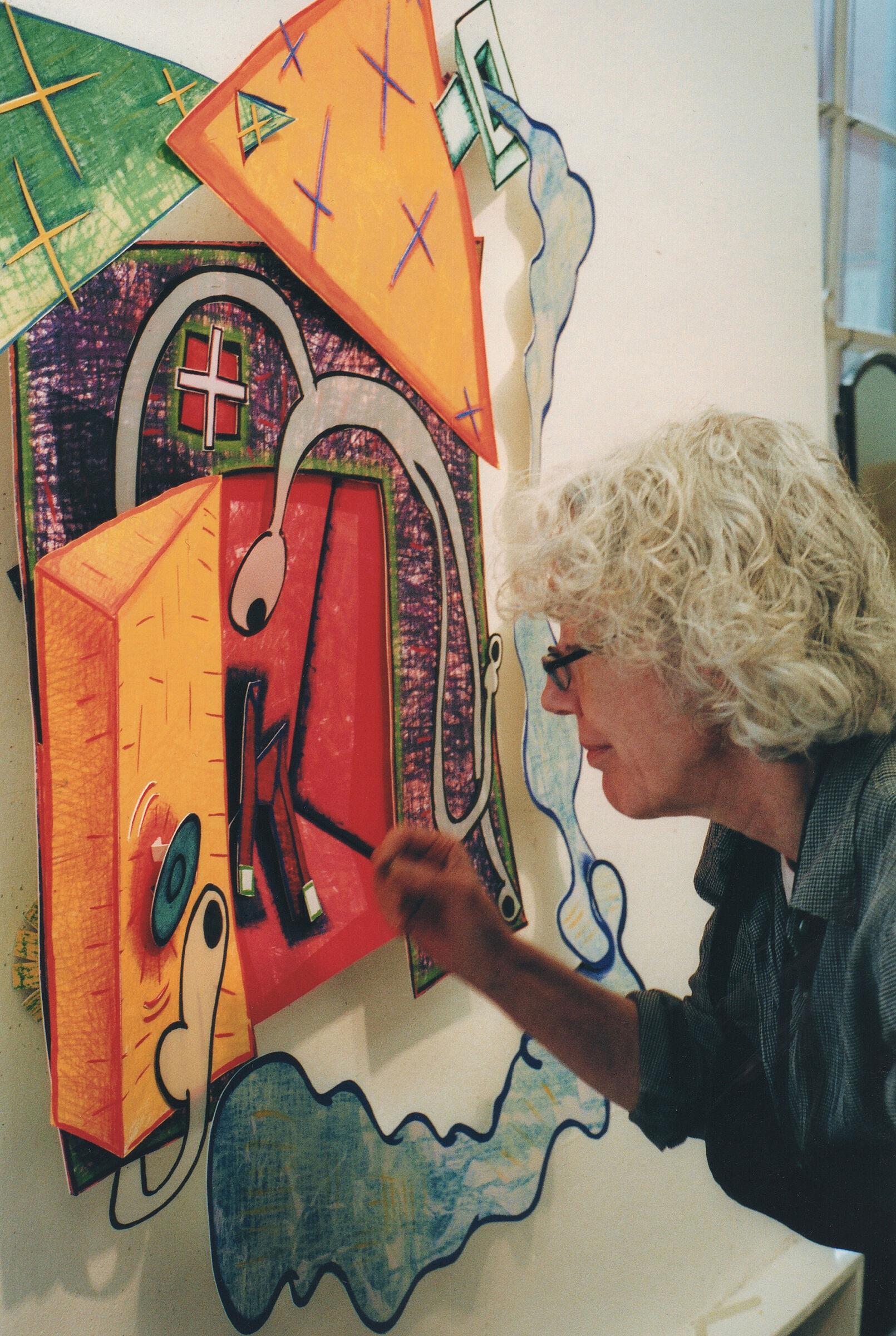 Artist Elizabeth Murray paints a work in her studio