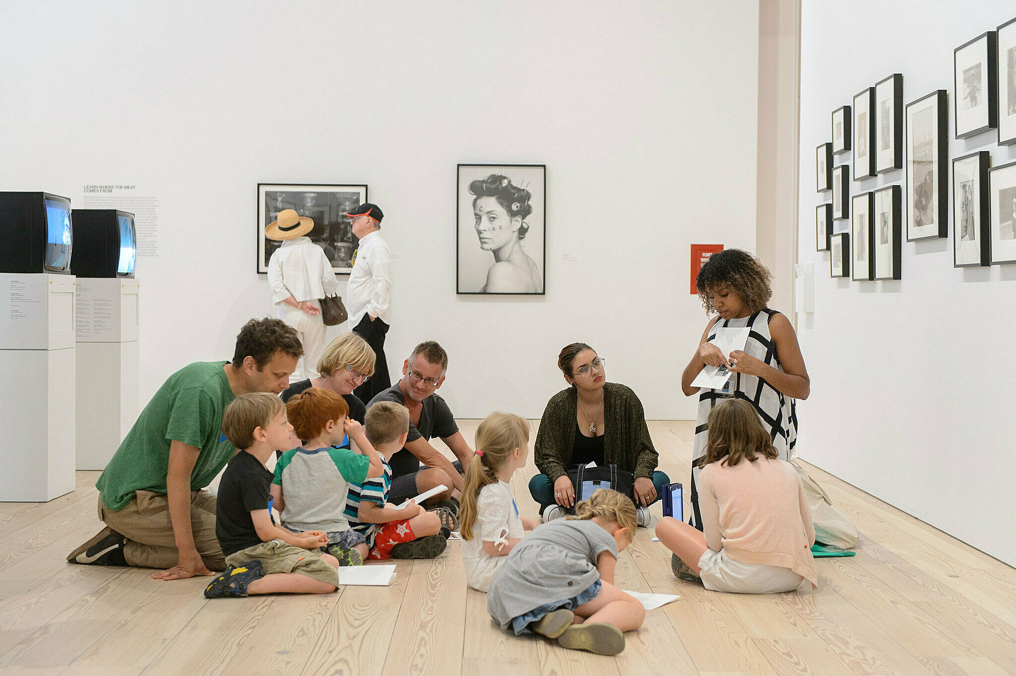 An educator leads a workshop in the galleries