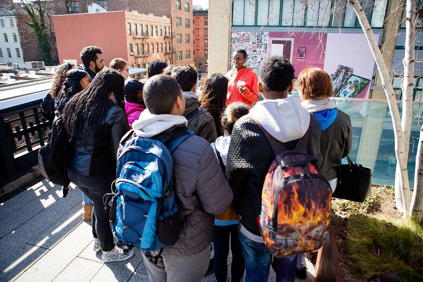 Students on a tour with artist Njideka Akunyili Crosby
