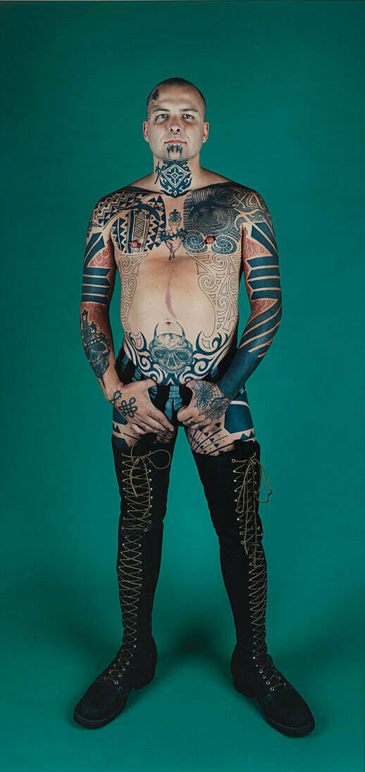 A work by Catherine Opie. Performance artist Ron Athey stands posing for a portrait