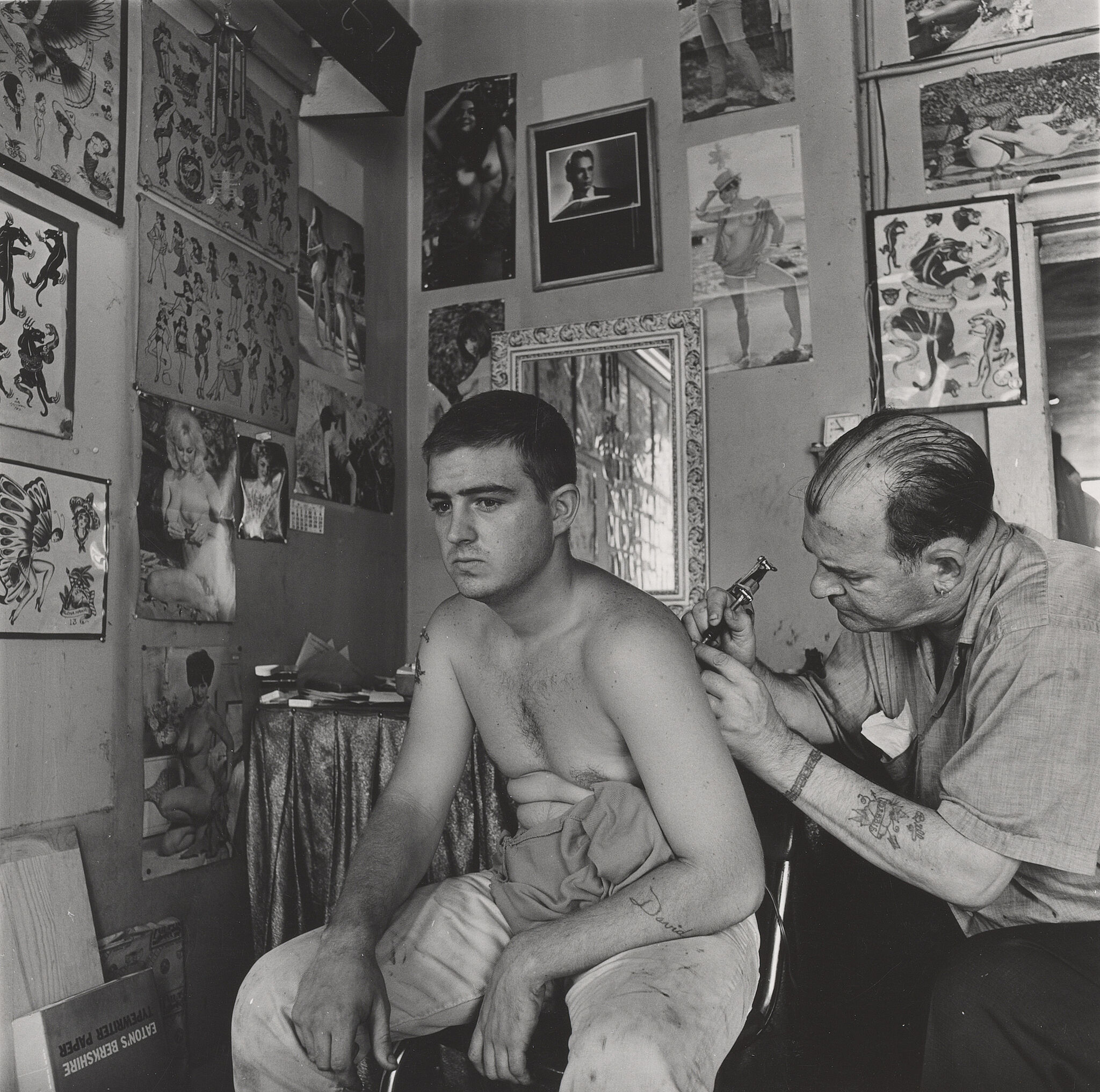 A work by artist Danny Lyon. A man is tattooed in a black and white setting
