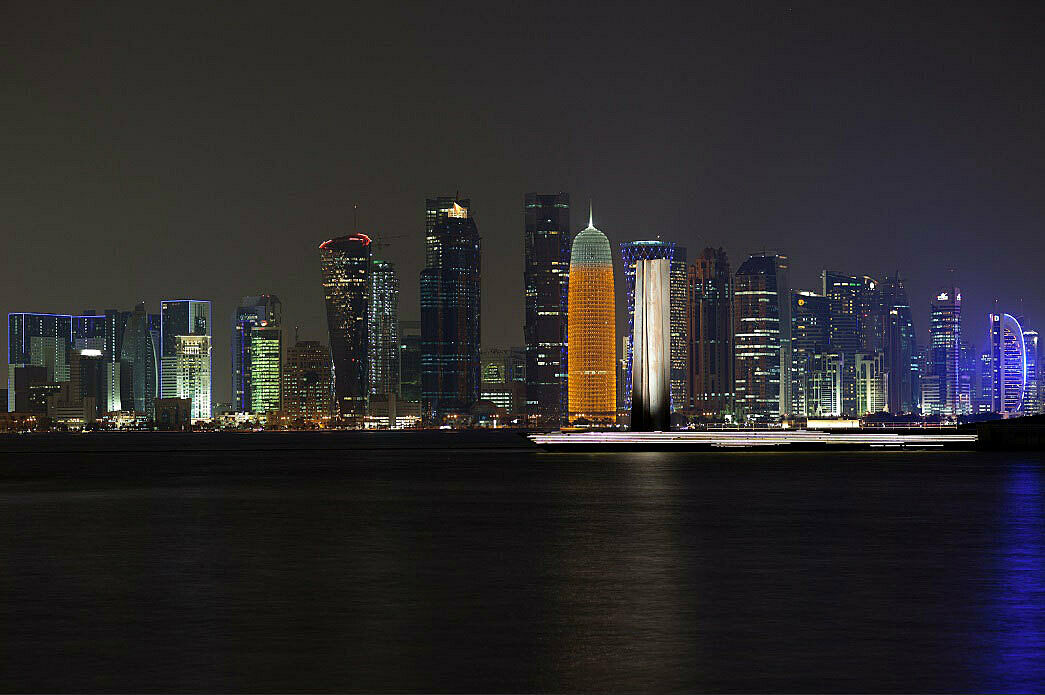 Doha skyline at night from across the water.