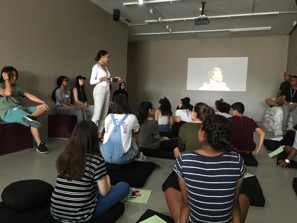 teens sitting preparing to meditate