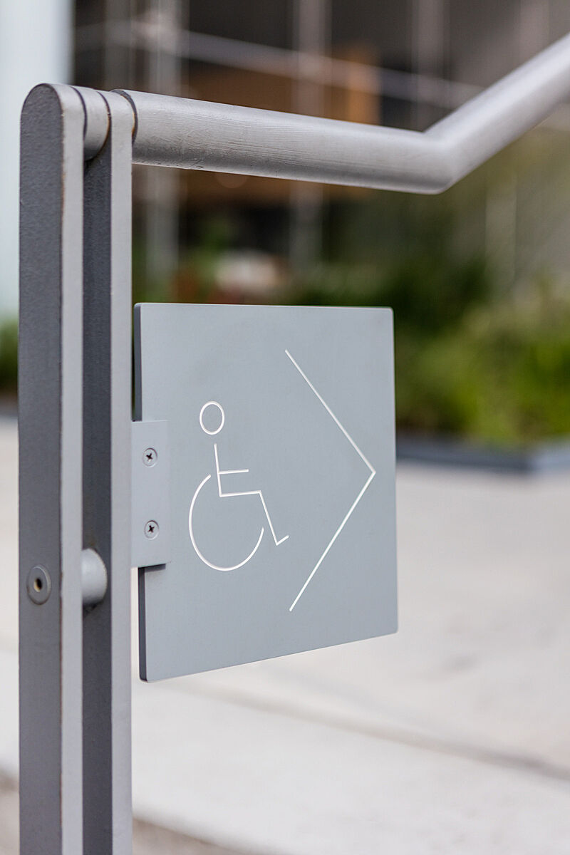 A sign indicating an accessible entrance.
