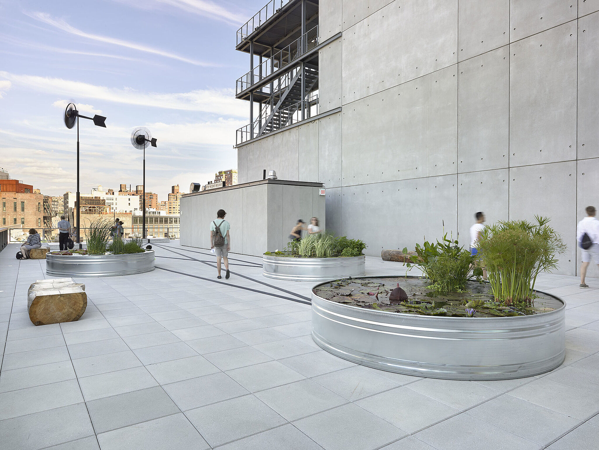 Virginia Overton's garden artwork installed on an outdoor terrace of the Whitney Museum.
