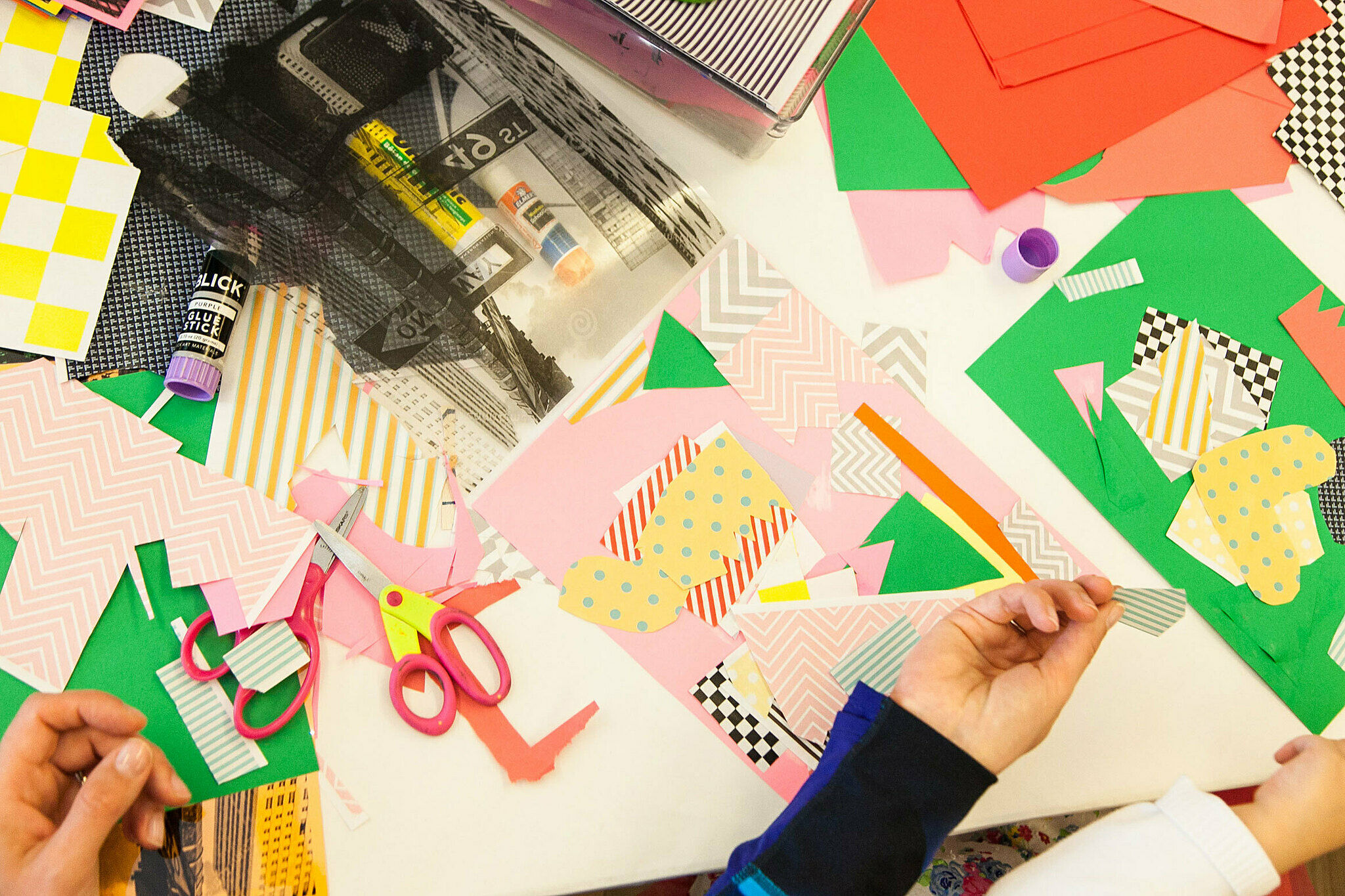 Kids use supplies to create artwork with paper