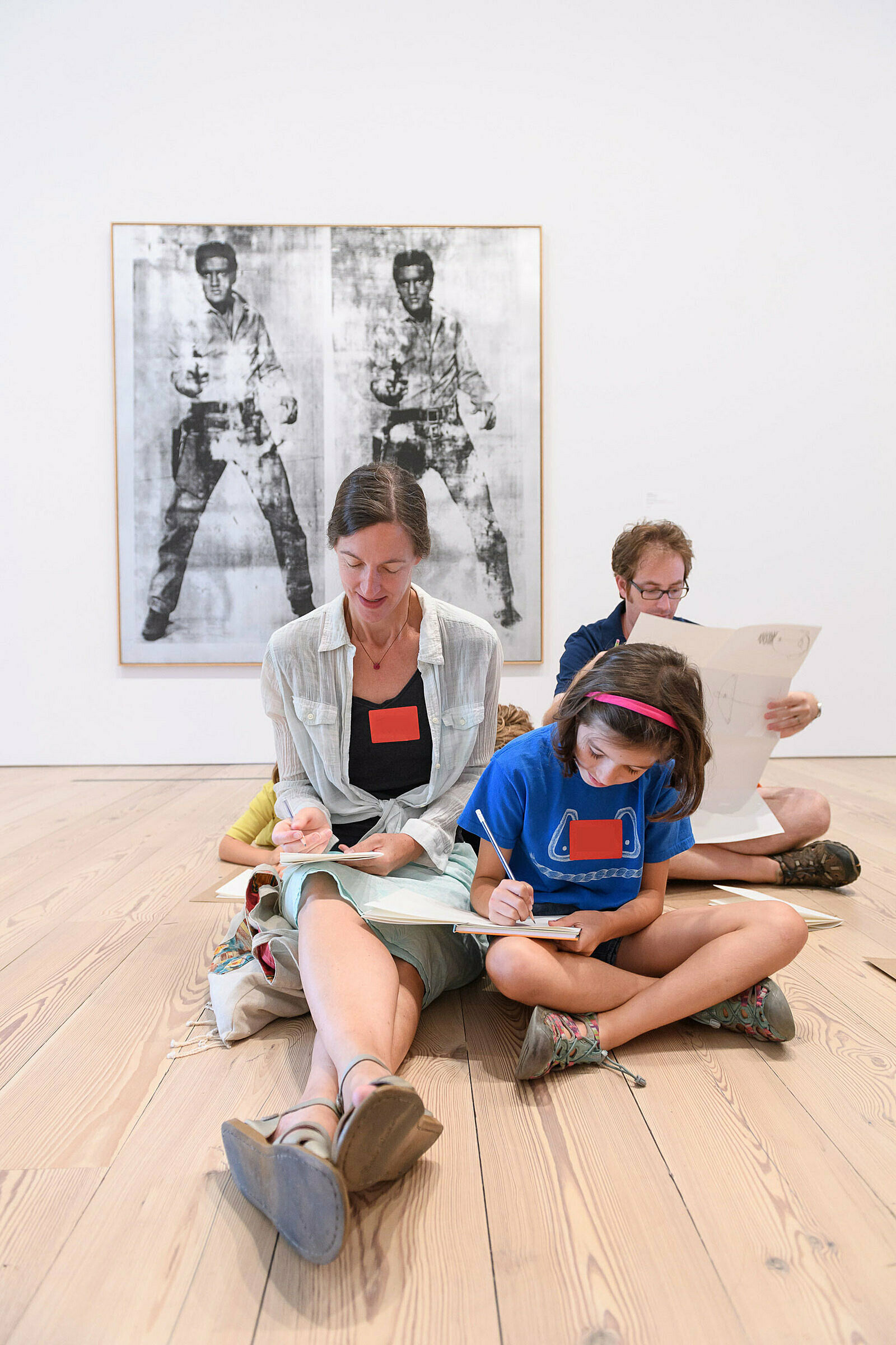 Families sketching in the galleries.