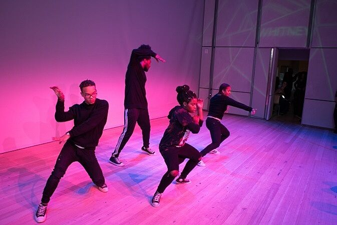Four dancers make a move on stage.