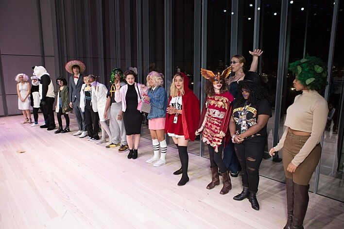 Several students show off their costumes to the audience.