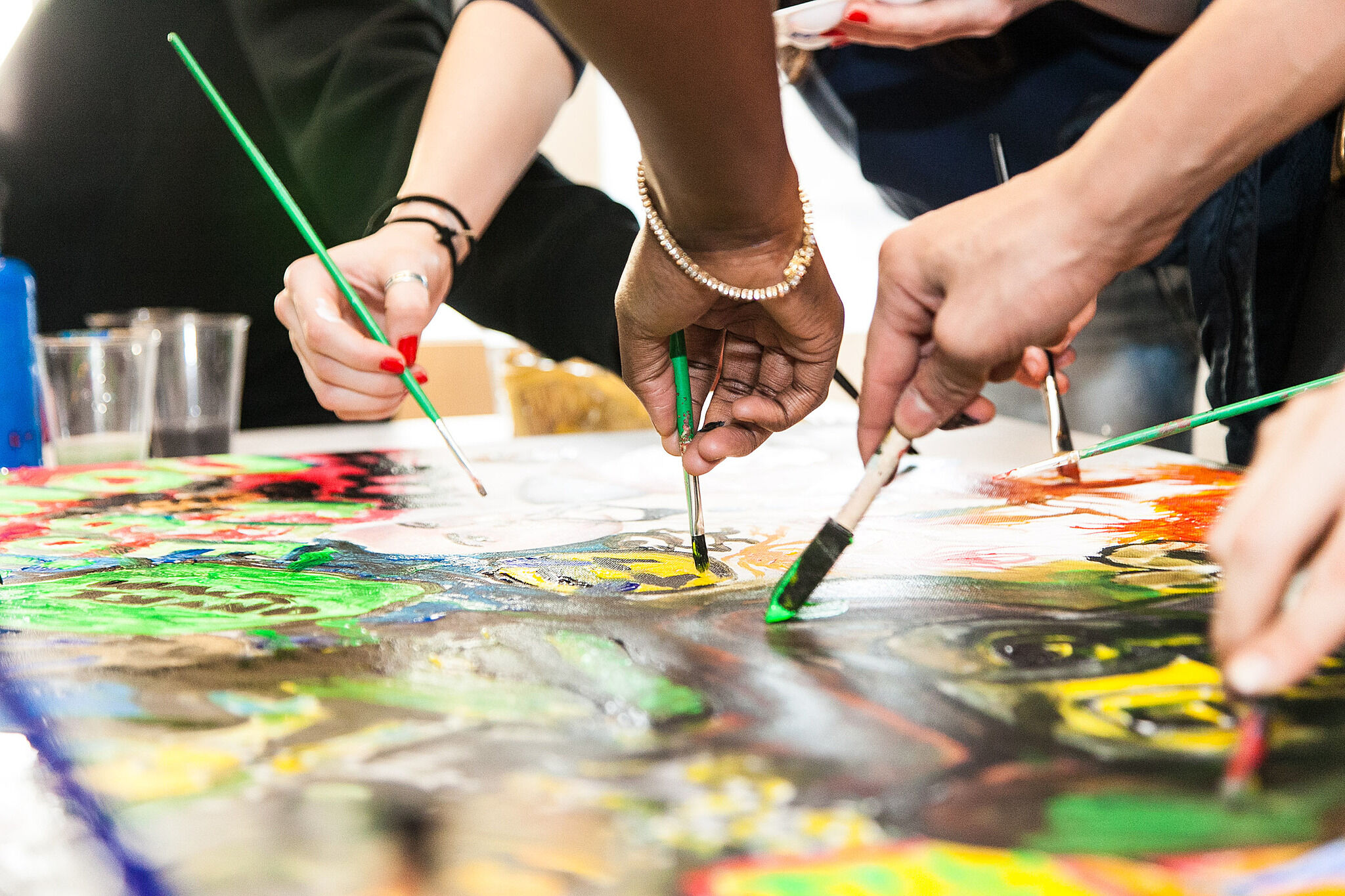 A group of teens paint together