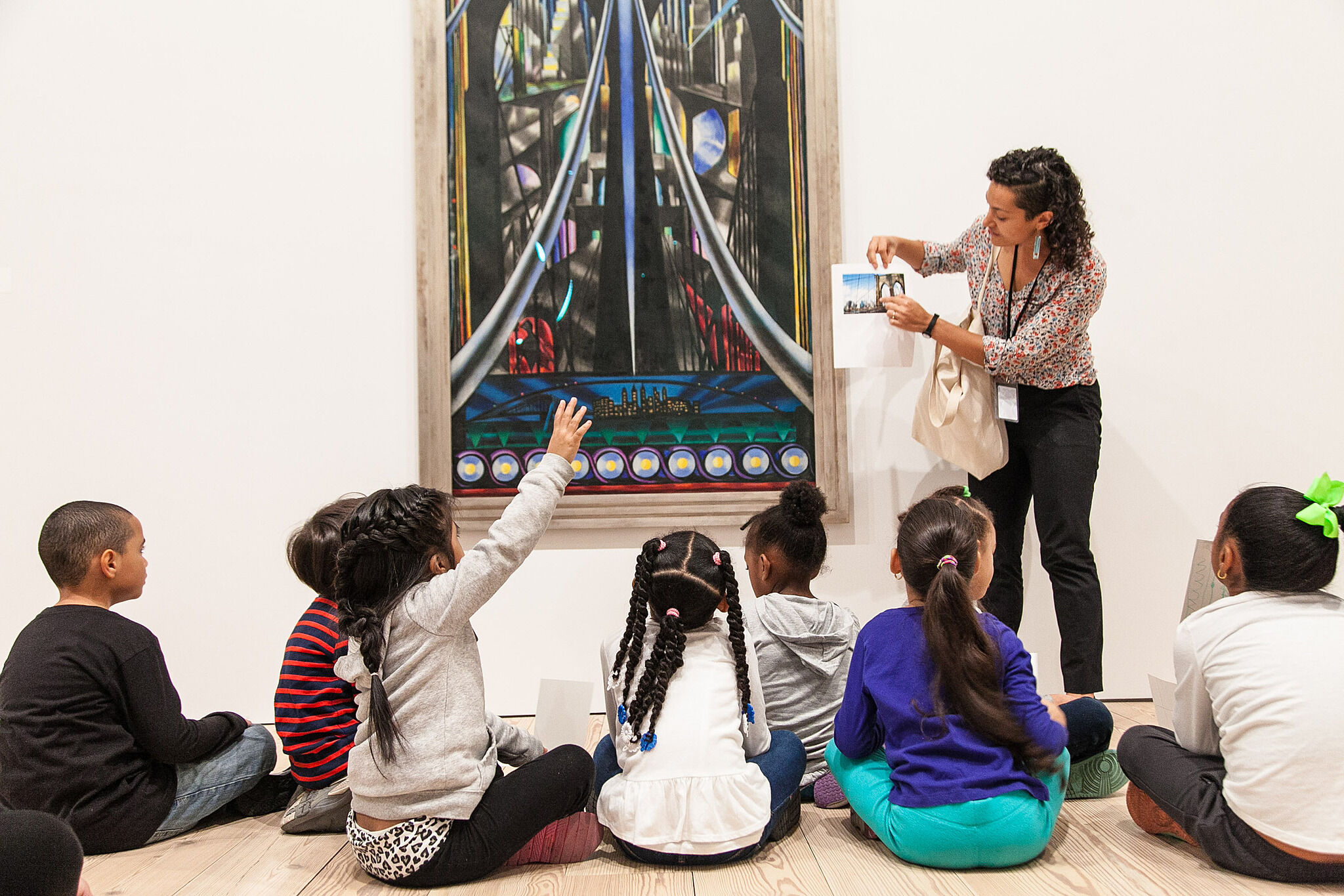 Kids look at a sculpture in the galleries