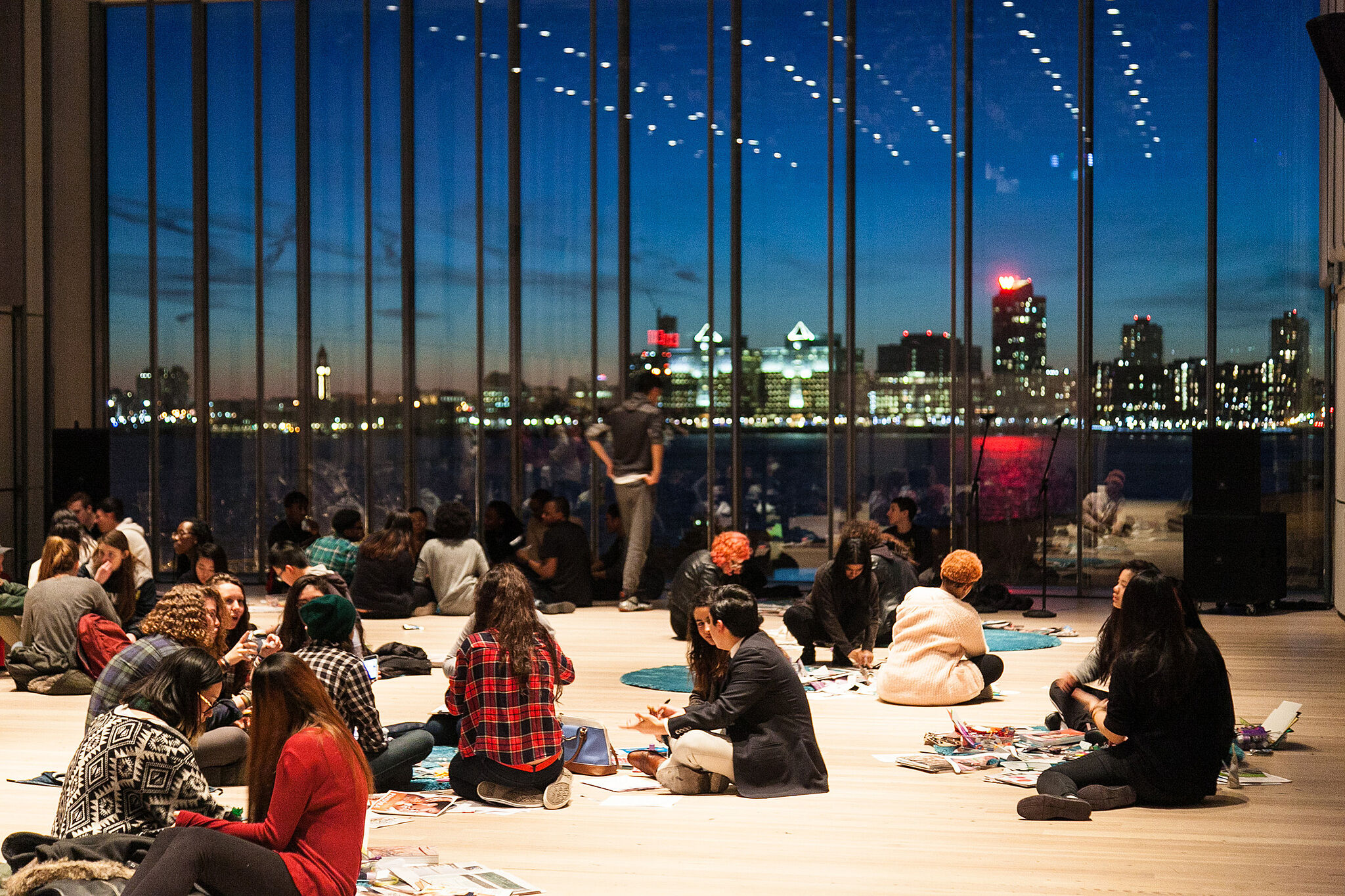 Teens gaze at the evening skyline from the Whitney theater