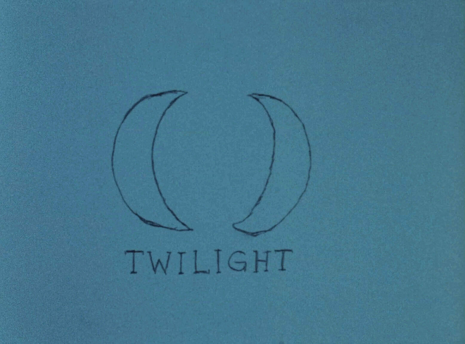 A still from a film work by Jenny Perlin. A hand drawn sketch of two moons and the word 'twilight' against a blue background